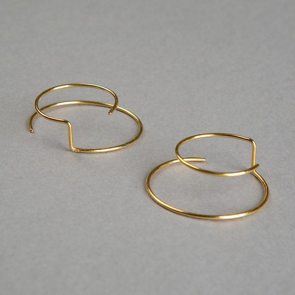 Órbitas - aretes de plata 925 con baño de oro de 18k