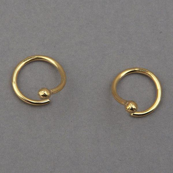 Gota Espiral - aretes de plata 925 con baño de oro de 18k